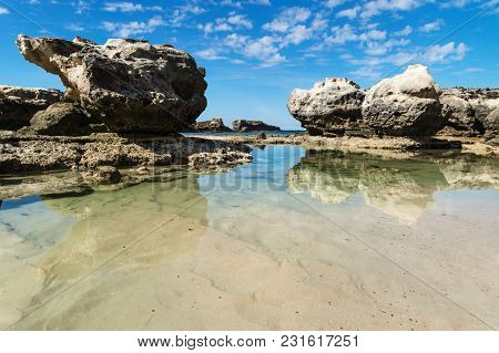 Rock Formation And Ocean Pool With Reflections In The Sea At Peterborough Beach Along The Great Ocea