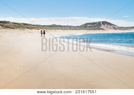 Victoria, Australia - 6 February 2018: Two Female Walkers At The Beach Of Peterborough At The Great