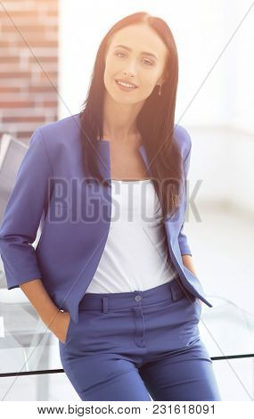 Portrait of successful businesswoman standing at her office.