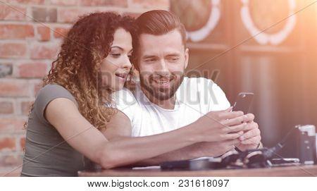 Beautiful couple having coffee on a date,having fun together.
