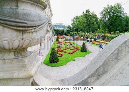 Salzburg Austria _ September 6 2017; Tourists Enjoy Walking In The Beautiful Mirabell Gardens View F