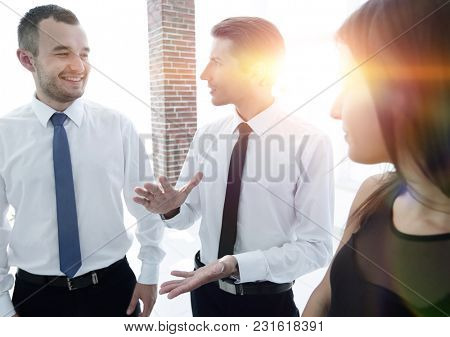 closeup of a business team discussing the current issues