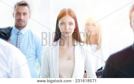 confident business woman among his colleagues