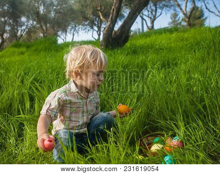 Curious Toddler With Basket Of Eggs