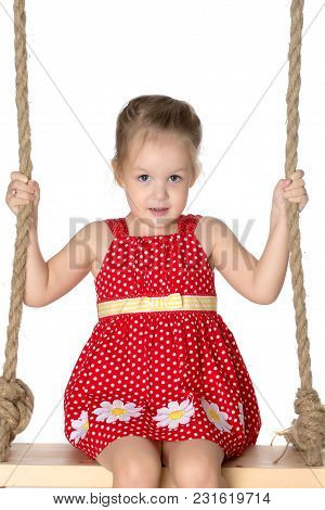 Beautiful Little Girl Swinging On Swing. The Concept Of Family Happiness, Child Development, Sports