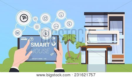 Hand Holding Digital Tablet With Smart Home Control And Administration System Interface Concept Flat