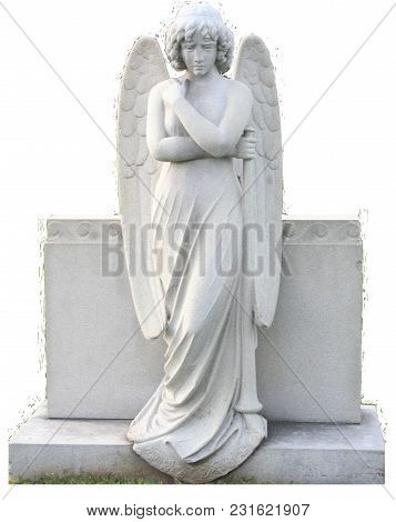 An Angel With Folded Arms And A Trumpet At Her Side.