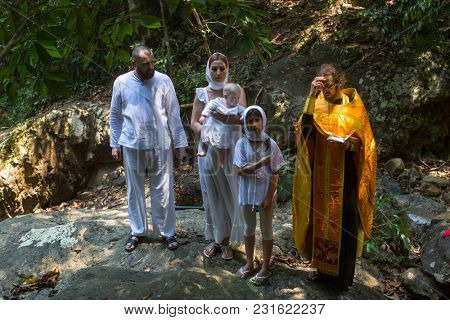 KOH CHANG, THAILAND - MAR 10, 2018: During Christian sacrament of spiritual birth - Baptism. There are currently 10 Orthodox parishes in Thailand, Orthodoxy is practiced by 0.002% of population.