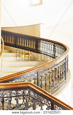 Marble Spiral Staircase With A Black And Brown Fence.it Is Like The Castle.