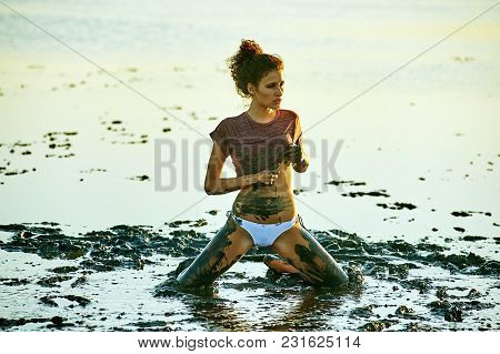 The Girl Takes A Mud Bath . Beauty Treatments At The Spa Resort