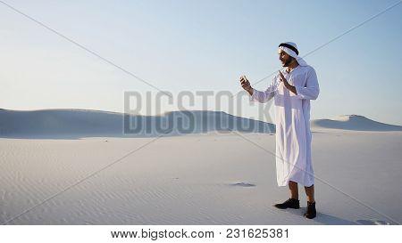 Cheerful Arabian Sheikh Male Tourist Calls Friend On Videocall B