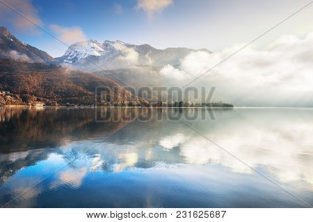 Annecy Lake In French Alps At Sunrise. Beautiful Autumn Landscape