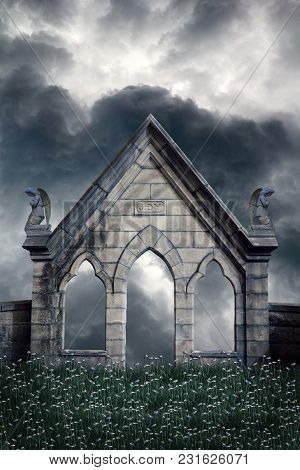A Structure With Kneeling Angels On Top, Looking At Stormy Skies.