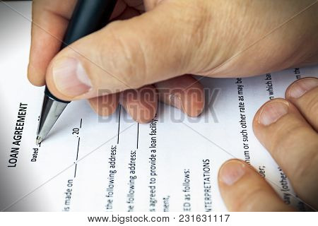 The Client Draws Up A Loan Agreement. Close-up