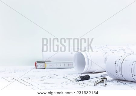 Engineering And Measuring Tools, Blueprint Rolls With Technical Plan On Architect Workplace Desk