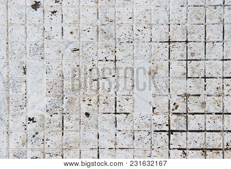 Small White Metal Square Tiles Covered With Dirt. White Background Made Out Of Small Tiles.