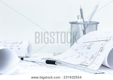 Technical Plans, Roll Blueprints, Engineering Tools On Architect Workplace Desk