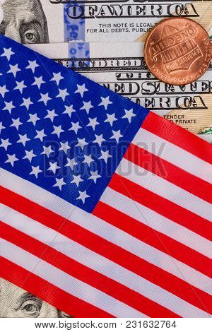 The American Flag Covers One Hundred Us Dollars. And One American Cent. Vertical. Close-up.