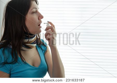 Sick Young Woman And Throat Spray