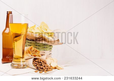 Summer Snacks  - Nachos, Croutons, Chips, Tortilla In Rustic Basket, Craft Paper Corners And Lager B
