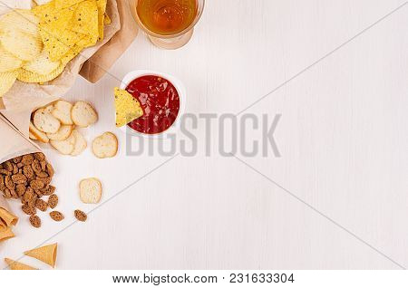 Crispy Golden Snacks On Craft Paper, Triangles Nachos, Lager Beer, Red And Yellow Sauce In Bowl On S
