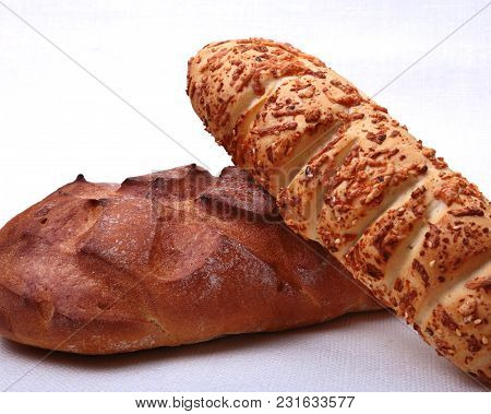 Assorted Fresh Homemade Bread On White Background. Selective Focus.