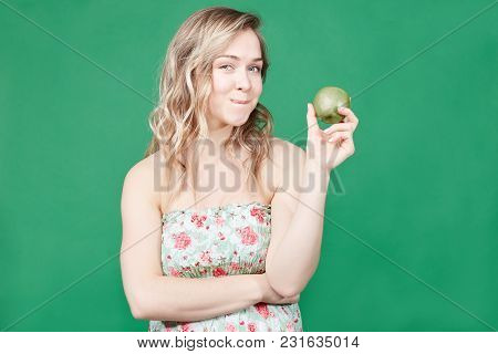 Healthy Food And Lifestyle Concept. Attractive Female Eats Fresh Apple, Thinks About New Diet, Being