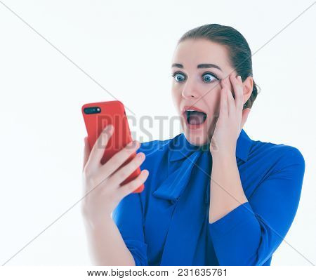 Close Up Portrait Of Pretty Young Woman Looking Shocked, Open Mouth And Eyes, Cell Phone Watching Sp