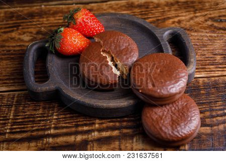 Romantic Treats Of Strawberries And Chocolate Cookies On A Wooden Board. A Treat For A Loved One.