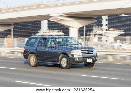 Dubai, Uae February 20, 2018: White Bentley Rides On The Road