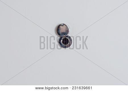 Open Door Peephole On The White Front Door.