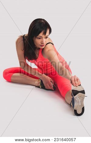 Young Woman Sport Stretching On The White Background. Studio Photography