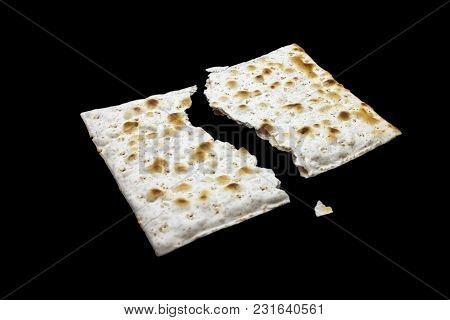 A Photo Of Two Pieces Of Matzah Or Matza Isolated On Black Background. Matzah For The Jewish Passove