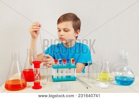 Young Smart Boy Doing Chemical Experiments In The Laboratory