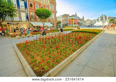 Braga, Portugal - August 12, 2017: Flower Beds And Tourist Walking In Avenida Da Liberdade, One Of T