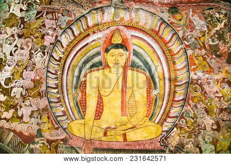 DAMBULLA, SRI LANKA - DEC 27, 2016: Buddha images inside Dambulla Cave Temple. Cave Temple is a World Heritage Site near Dambulla city on Dec 27, 2016. Sri Lanka.