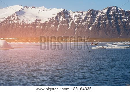 Volcano Rock Mountain Over Blue Lake, Iceland Winter Season Natural Landscape Background