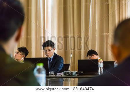 Wuhan, China - 28 October 2017 - Unidentified Young Business Man Pay Attention On His Notebook Compu
