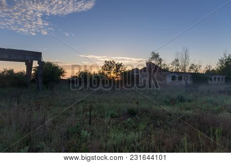 Sunrise In An Abandoned Area. Abandoned Buildings.