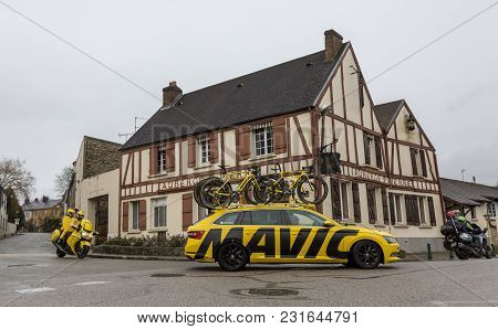 Dampierre-en-yvelines, France - March 4, 2018: The Yellow Technical Car Of Mavic And The Bike Of Lcl