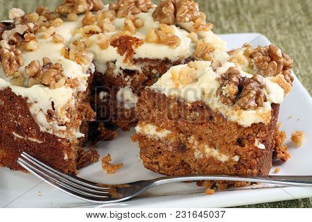 Whole Delicious Carrot Cake With Butter Cream Icing And Walnuts