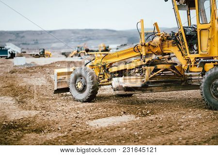 Industrial Road Construction Site, Highway Building. Heavy Duty Machinery Working On Site