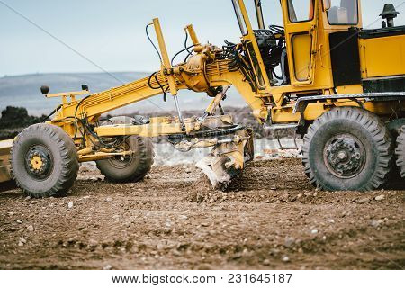 Highway Construction Site Development With Motor Grader Moving Earth, Soil