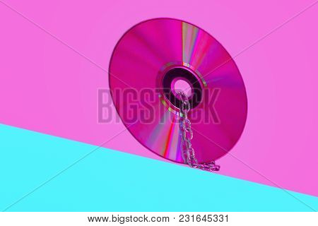 Disc On Pink And Green Background, Design