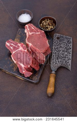 Uncooked Beef Meat On Cutting Board With Knife
