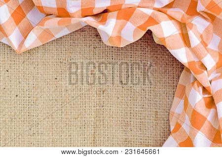 Orange Folded Checkered Rural Tablecloth Over Canvas Shaped Like Frame