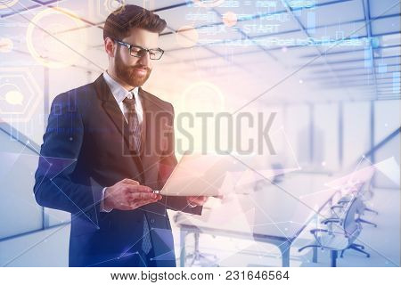Businessman Using Laptop On Abstract Meeting Room Background With Glowing Digtal Interface. Future A