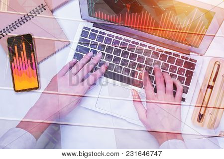Accounting And Information Concept. Hands Using Laptop With Forex Chart Placed On Office Desk With S