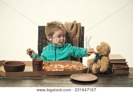 Baby Food. Child Is Feeding Toy Bear. Kid Shares Food With Friend. Pizza And Porridge For Lunch. Piz