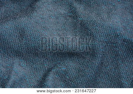 Gray Background Of Fabric Made From Crumby Woolen Cloth